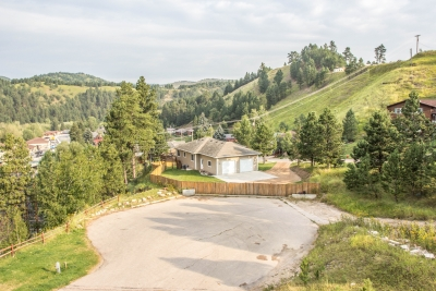Fantastic Deadwood Views with 4 bedrooms and 2 car Garage